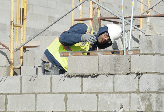 Anthony Weber | Troy Daily News Workers continue construction at Bethel Local Schools this week. Milder temperatures have helped in the progress of the building in Bethel Township.