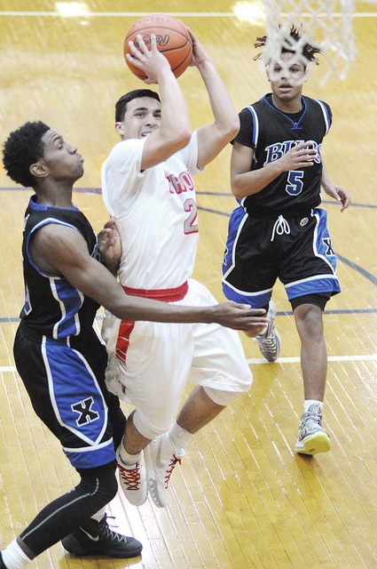 Anthony Weber/Troy Daily News Troy's Romello Yaqub drives to the basket against Xenia in the opening round of the Division I sectional tournament Friday at Butler.