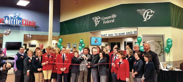 Provided photo Greenville Federal Bank President and CEO Jeff Kniese, along with employees and members of the Troy Area Chamber of Commerce, cut the ribbon for the grand opening of the new location inside the Troy Kroger Marketplace on Feb 4.