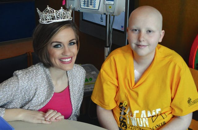 Provided photo Miss America 2016 Betty Cantrell visits with Troy High School sophomore Shelby Mathes recently at Dayton Children's Hospital. The two played a little of the board game Sorry during their visit.