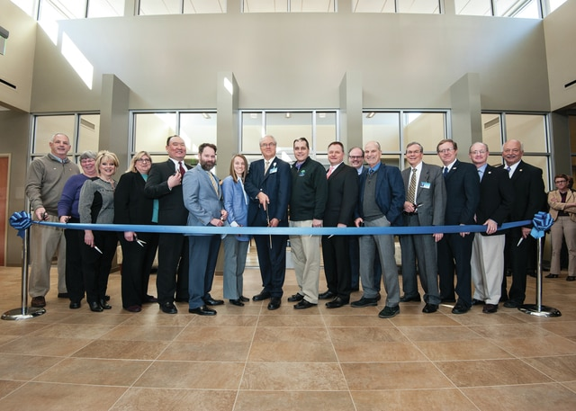 Provided photo Staff and officials, along with members of the Tipp City Area Chamber of Commerce, celebrate the ribbon cutting of the new Kettering Health Network and The Orthopaedic Institute of Dayton building in Tipp City.