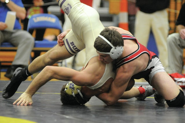 Photo Courtesy of Ben Robinson | GoBuccs.com Milton-Union's Kamron Paulus (right), shown here competing at last week's Division III sectional tournament, will be looking to earn a return trip to state this weekend.
