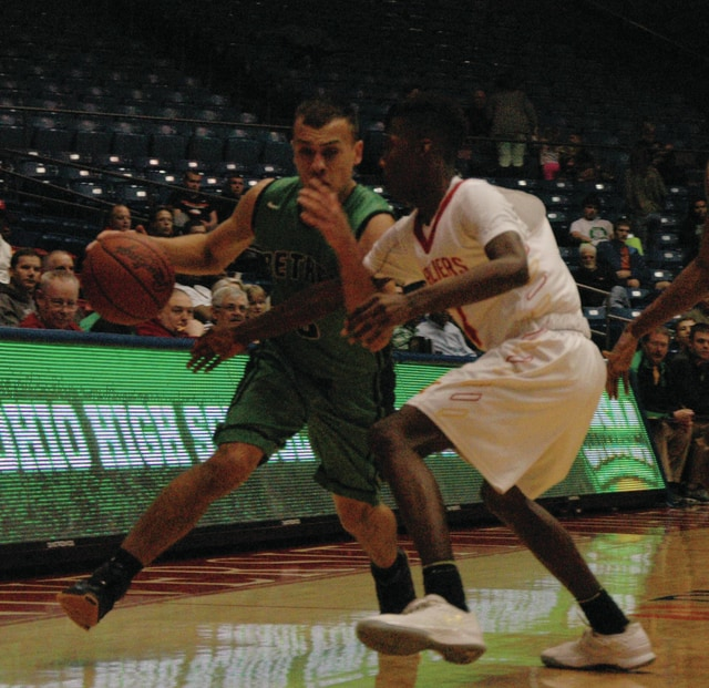 Josh Brown/Troy Daily News Bethel's Caleb South drives around a Purcell Marian defender during the Division III district final Wednesday at UD Arena.