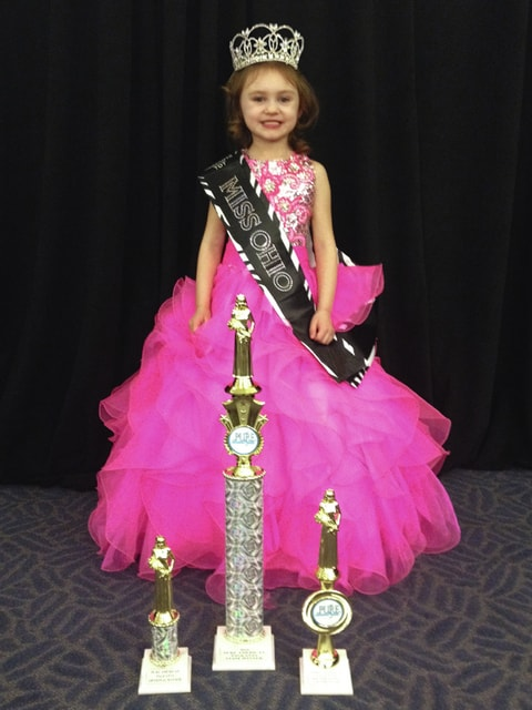 Provided photo Emma Rose Fisher won the title of Miss Ohio in the Tot Division from Pure American Pageants at the Ohio State Pageant on March 5. Also, Emma Rose received two additional awards, one for her Community Services in the state of Ohio and a Photogenic Award.