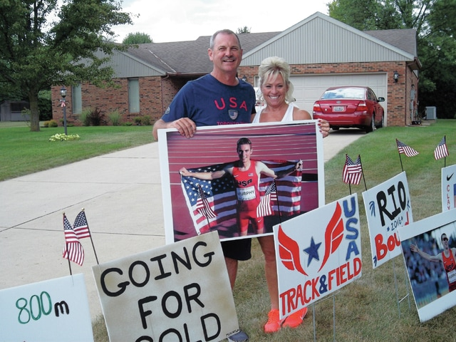 Sharon Semanie | For the Daily Call Mark Murphy, father of Olympic track and field competitor Clayton Murphy, and friend Christal Ford, show their support for the 21-year-old runner at their Piqua home.