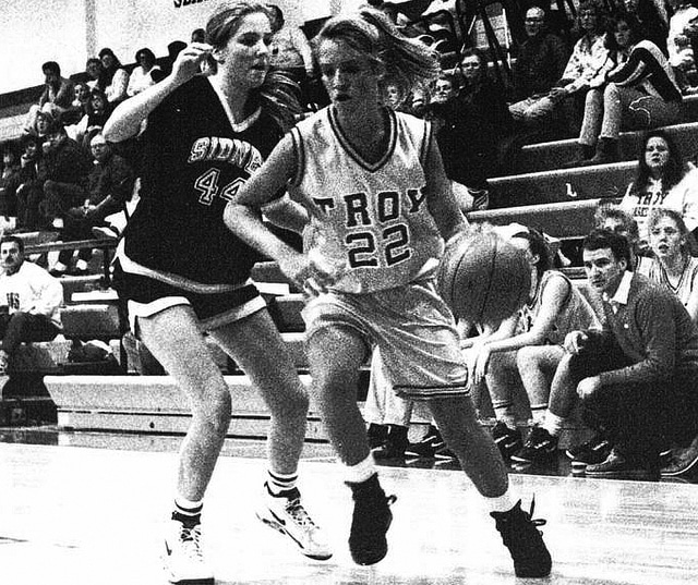 Provided Photo Julia (Reel) Niles, right, shown here playing basketball against Sidney in 1992, is a member of the Troy Athletic Hall of Fame Class of 2016.