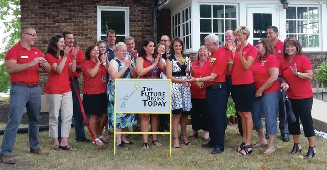 Provided photo Natalie Rohlfs, executive director of The Future Begins Today, cuts the ribbon on the new location of The Future Begins Today at 305 W. Staunton Road, Troy.