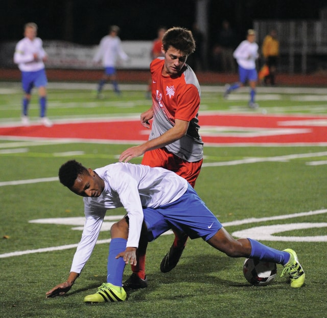 Josh Brown/Troy Daily News Troy's Ben Schreiber battles a Springboro defender for the ball during the Division I sectional final Monday at Bellefontaine High School.