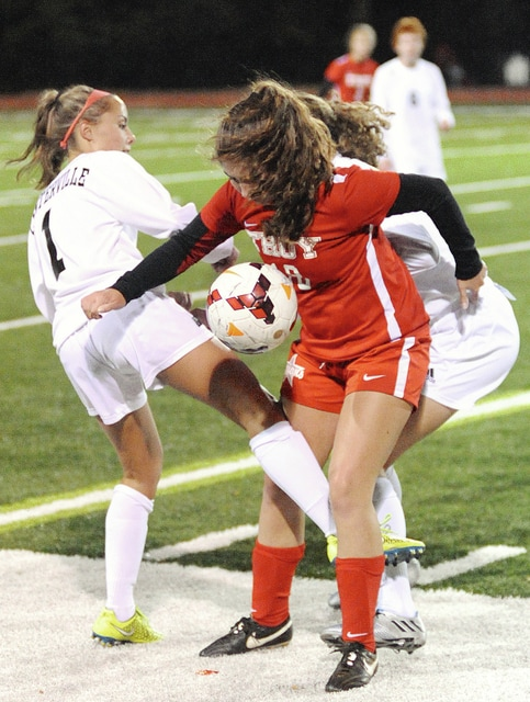 Anthony Weber/Troy Daily News Troy's Olivia Westfall battles a Centerville player for the ball along the sideline during the Division I sectional title game Tuesday at Bellefontaine High School.