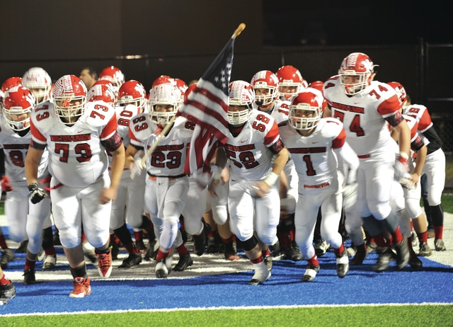 David Fong/Troy Daily News The Milton-Union football team charges the field before its Division V, Region 20 semifinal playoff game against CHCA Saturday at Miamisburg High School.