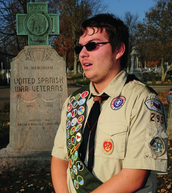 Mike Ullery   Daily Call Piqua High School senior ElijahBloom talks about the completion of his Eagle Scout Project at Forest Hill Cemetery last week.
