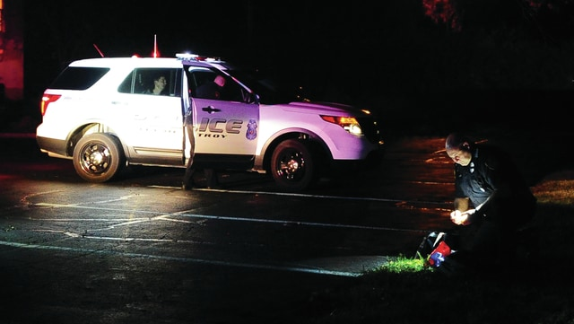 Mike Ullery   Daily Call Troy police search for evidence after taking two suspects into custody following a theft at Royal Inn on Friday evening.