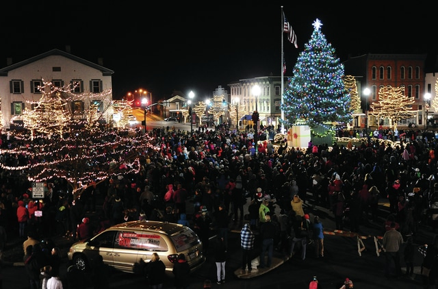 Mike Ullery | Civitas Media Hundreds of people gathered on the square in downtown Troy on Friday for the annual Grand Illumination event as Santa Claus and helpers lit the city Christmas Tree.