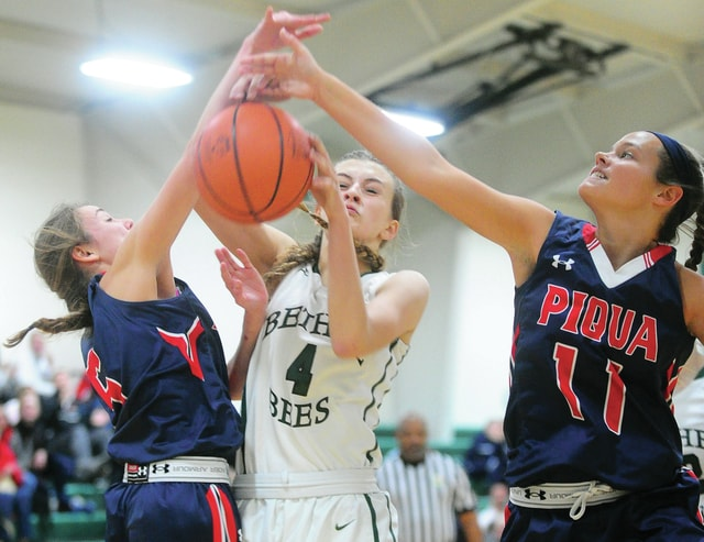 Mike Ullery/Civitas Media Bethel's Claudia Lowery is double-teamed by Piqua's Ainsleigh Spradlin (5) and Claire Went (11) Saturday at Bethel.