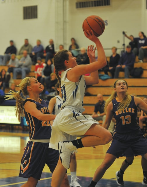 Josh Brown/Troy Daily News Miami East's Kaitlyn Mack lays the ball in against Butler Saturday.