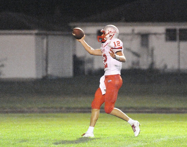 Anthony Weber | Troy Daily News Troy's Troy quarterback Hayden Kotwica (12) runs the ball in for a touchdown against Fairborn. Kotwica was named Greater Western Ohio Conference American North Division Athlete of the Year.