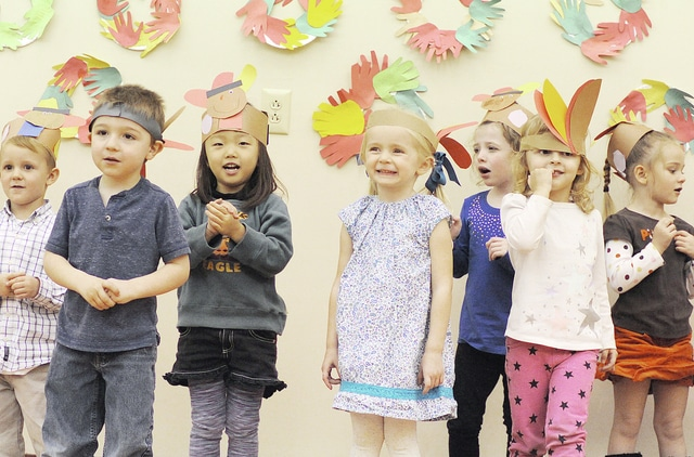 Anthony Weber | Troy Daily News Children of The Little Lighthouse perschool and child care center perform songs and recite scripture Friday in Tipp City. Staff and families of the center gathered during an annual Thanksgiving feast as a the holiday approaches next week.