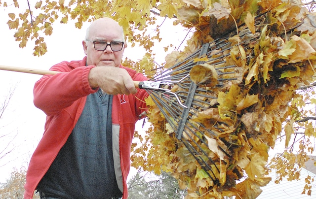 Anthony Weber | Troy Daily News Troy resident Chuck Klein cleans up around the yard Tuesday as temperatures rose into the 60s. Warmer weather allowed people to get outside while temperatures were above normal.