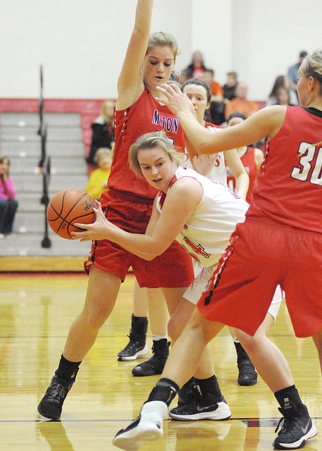 Anthony Weber/Troy Daily News Newton's Mallory Dunlevy (34) tries to work around a double team by Milton-Union's Liz Renner (40) and Taylor Jacobs (30) Tuesday night.