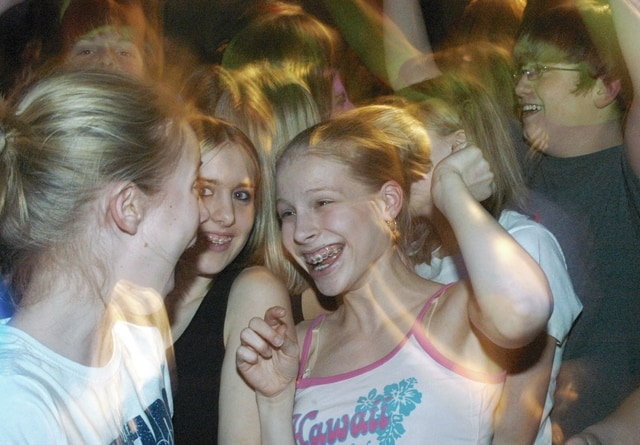 Anthony Weber | Troy Daily News Youth participate in a Friday night dance at The Rec in February 2004.