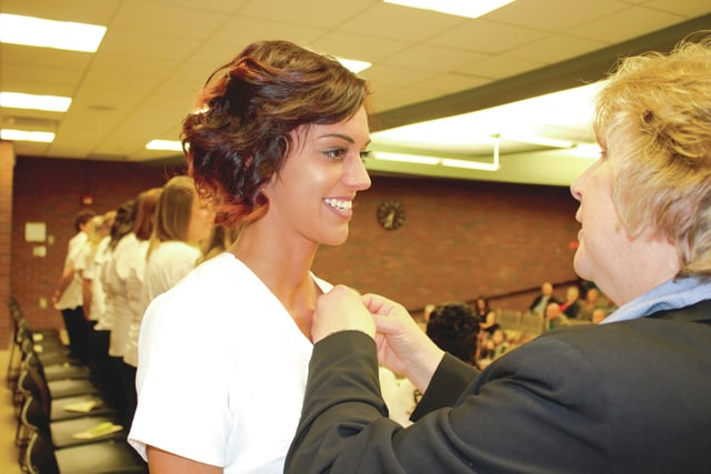 Provided photo Destini Speraw of Troy is pinned by Program Director Lori Ludwig during her recent graduation from Upper Valley Career Center's Adult Division Practical Nursing program. Speraw also was commended for superior attendance.