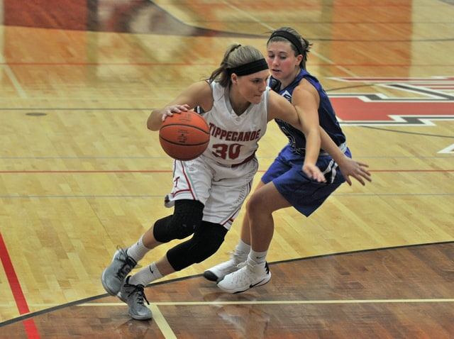 Josh Brown/Troy Daily News Tippecanoe's Allison Mader drives around a Miami East defender Wednesday.