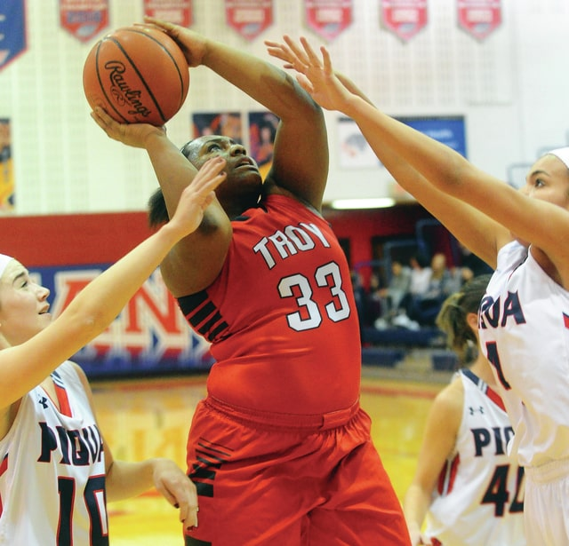 Mike Ullery/Civitas Media Troy's Alaura Holycross puts up a shot in heavy traffic against Piqua Wednesday night. Holycross had a career-high 21 points in the Trojans' victory over the Indians.