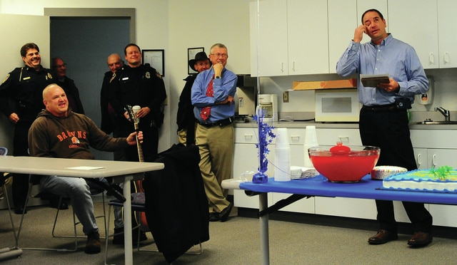 Mike Ullery | Civitas Media An emotional Branden Fellers, right, talks about his retirement during a gathering in his honor at the Troy Police Department on Thursday. Fellers served the citizens of Troy for 27 years.