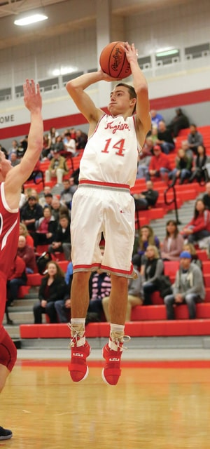Photo courtesy Lee Woolery/Speedshot Photo Troy's Ryan McClurg scored a career-high 33 points in the Trojans' win over Piqua Friday at the Trojan Activities Center.