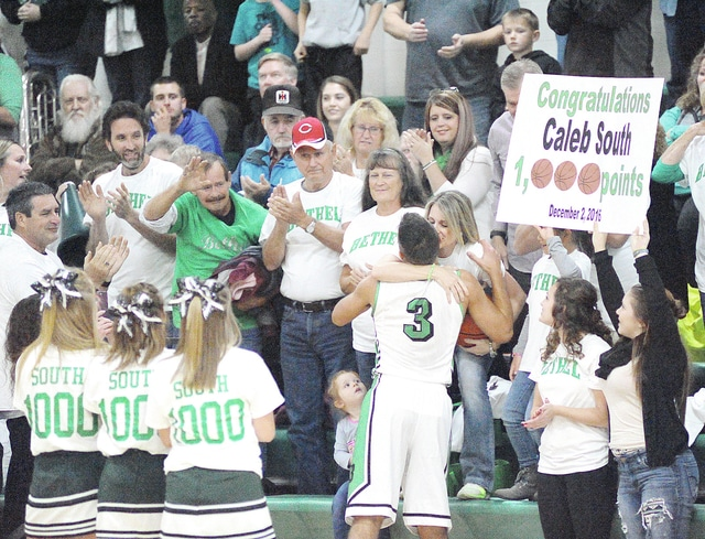 Anthony Weber/Troy Daily News Bethel's Caleb South (3) is embraced by his mother, Laura South, after giving her the game ball after he scored his 1,000th career point early in Friday night's season opener against Ansonia. South scored 30 points in the Bees' 61-37 victory.