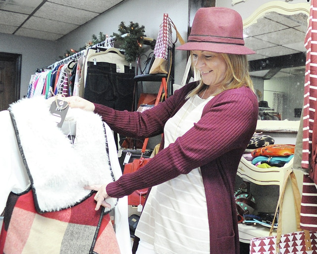 Anthony Weber | Troy Daily News Melissa Rhoads recently opened a women's clothing and accessories boutique, Sweet Melissa. Her shop is located at 16 N. Market St., above LimeLight Salon in downtown Troy.