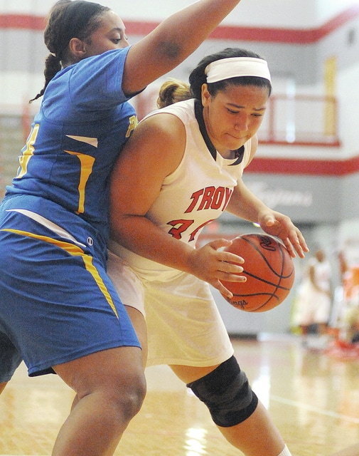 Anthony Weber/Troy Daily News Troy's Tia Bass works in the post against Ponitz Saturday at the Trojan Activities Center.
