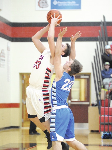 Anthony Weber/Troy Daily News Milton-Union's Blake Ullery scores in the post Tuesday against Franklin Monroe.
