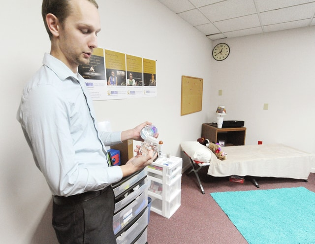 Anthony Weber | Troy Daily News Ian Ridgeway from The Tri-County Board of Recovery and Mental Health Services discusses items hidden in plain sight while promoting awareness to using along with promoting conversation among parents and kids recently at the Stouder Center.