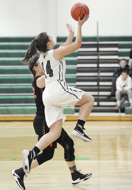 Anthony Weber/Troy Daily News Bethel's Delaney Hardert goes in for a fast break layup as Bradford's Bailey Wysong defends Thursday night.
