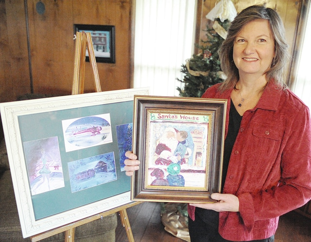 """Anthony Weber   Troy Daily News Jacqui Noll displays several works, including her """"Santa on the Square"""" piece Wednesday at her home near Covington. Noll is in the 11th — and final — year of her series titled """"A Troy Christmas."""""""