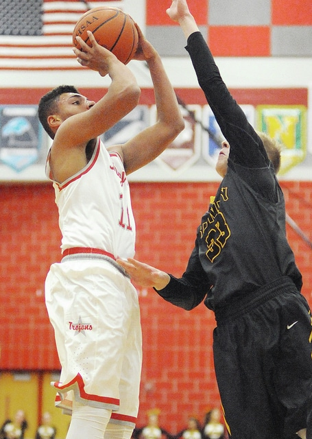 Anthony Weber/Troy Daily News Troy's Brenden Kinnel pulls up for a jumper Tuesday against Sidney.