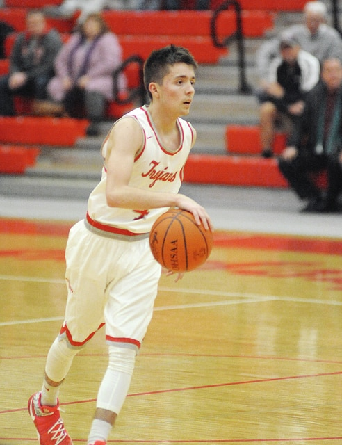 Anthony Weber/Troy Daily News Troy's Eli Palmer brings the ball up the floor Tuesday against Urbana.