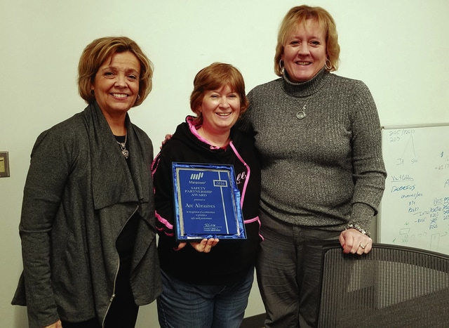 Provided photo From left, Barb Vedder, area manager of Manpower, Carleen Kemper with Arc Abrasives, and Laurie Voigt, risk management director of Manpower.