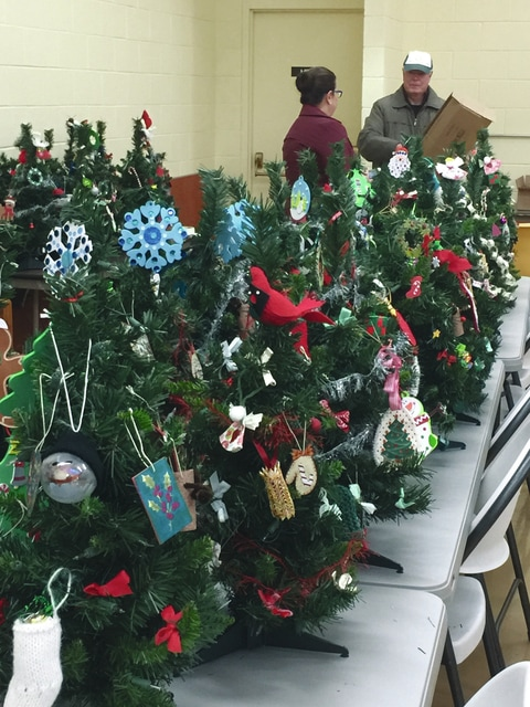 Provided photo Volunteers at Ohio's Hospice of Miami County have decorated and will deliver 150 Christmas trees to hospice patients.