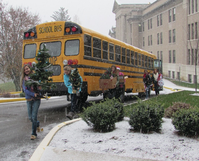 Fairlawn Middle School student council helps carry Christmas trees into the lobby of the Ohio Masonic Home in Springfield on Tuesday morning. More than 100 trees were distributed to residents as part of Operation Christmas Cheer.
