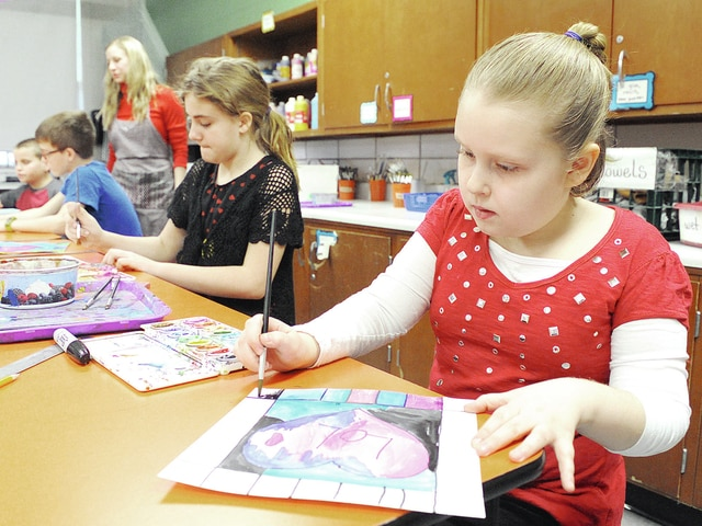 Anthony Weber | Troy Daily News Fourth-grade students of Brooke Dansereau's art class created hearts reflecting the work of Peter Max on Tuesday at Hook Elementary School. Dansereau, who is an art teacher for both Hook and Heywood Elementary schools, said it was a project that was quick and fun.