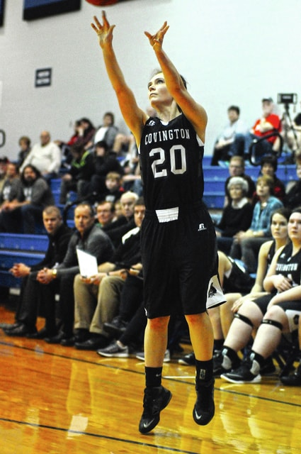 Ben Robinson/GoBuccs.com Addison Metz hits one of her three 3-pointers for Covington Wednesday night.