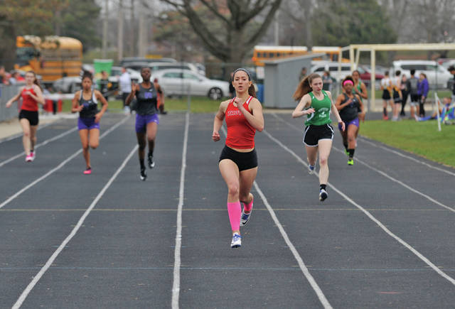 Josh Brown/Troy Daily News Troy's Ashley Barr leaves the competition behind in her heat of the 400 Saturday at Troy's Up and Running Invitational.