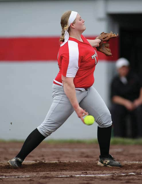 Photo courtesy Lee Woolery/Speedshot Photo Troy's Hallie Snyder fires a pitch Thursday against Wayne. She and Erica Keenan combined on a no-hitter as the Trojans won their home opener 11-1 in five innings.