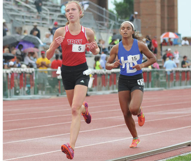 Josh Brown | Troy Daily News file Troy distrance runner Morgan Gigandet (left) will continue her quest for a state title this spring.