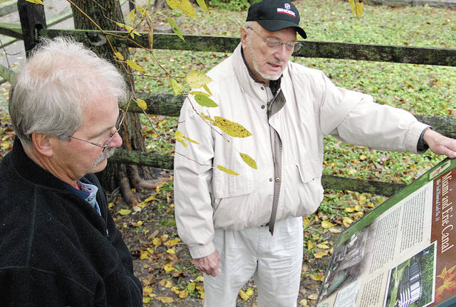 Anthony Weber | Troy Daily News Neil Rhoades, left, and Bob Shook meet along the Great Miami River Recreational Trail in the area of Lock 14 on Oct. 20, 2011.