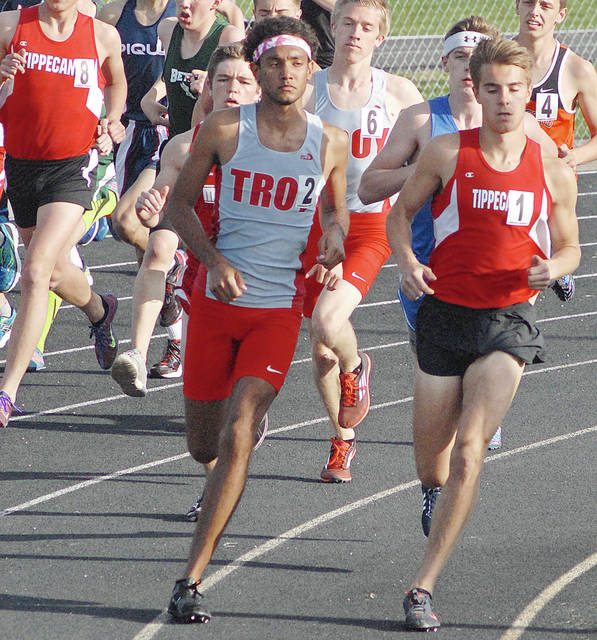 Anthony Weber/Troy Daily News file Troy's Stephen Jones and Tippecanoe's Mitch Poynter battle it out at last year's Miami County Invitational.