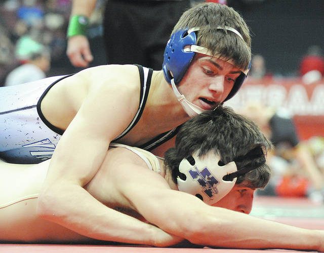 Anthony Weber | Troy Daily News Miami East's Alex Isbrandt battles his opponent Alex Rhine from Mechanicsburg, in the Division III 132 pound Championship Match, at the 80th Annual State Wrestling Tournament inside the Value City Arena Schottenstein Center Saturday in Columbus.