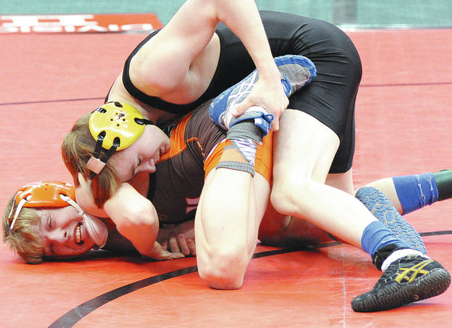 Anthony Weber | Troy Daily News Troy Christian's Ethan Turner battles Collin Yinger from Nelsonville-York in the consolation finals during the 80th Annual State Wrestling Tournament at the Value City Arena Schottenstein Center Saturday in Columbus.